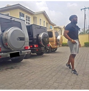 """""""Happy G Day"""": Timaya Poses With 3 G-Wagons With Different Colours"""